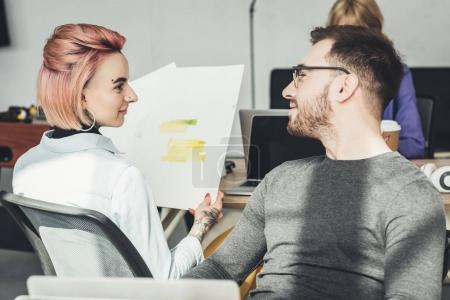 selective focus of group of creative workers working in office