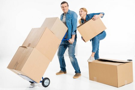 Photo for Woman helping man holding trolley cart with cardboard boxes isolated on white - Royalty Free Image