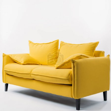 Photo for Studio shot of yellow couch with pillows, on white - Royalty Free Image