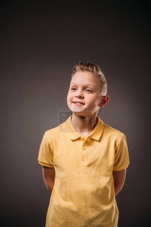 portrait of adorable preteen boy, isolated on grey
