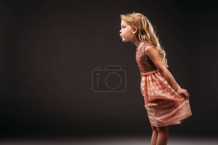 pretty child in pink dress, isolated on grey