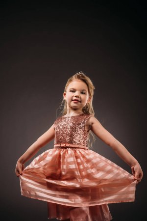 adorable elegant child in pink dress, isolated on grey