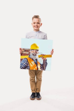 little smiling boy pretending to be workman, isolated on white