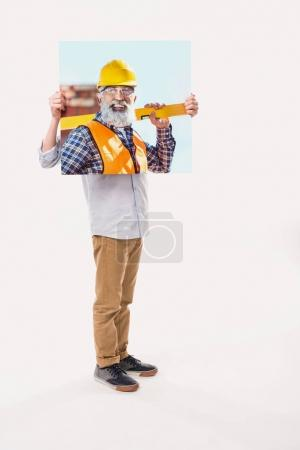 little boy pretending to be professional builder, isolated on white