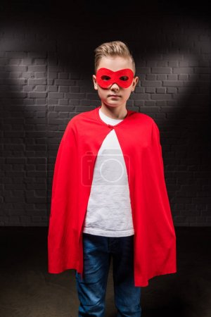 boy in superhero costume and red mask