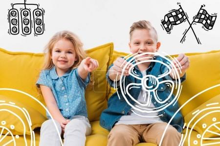 little boy driving drawn car and sister pointing while sitting on yellow sofa