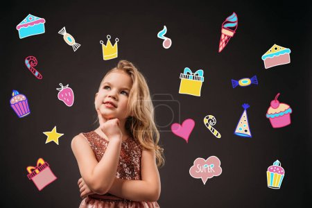 adorable thoughtful child in pink dress, isolated on grey with birthday icons