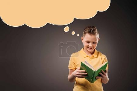 preteen boy reading book, isolated on grey with speech bubble