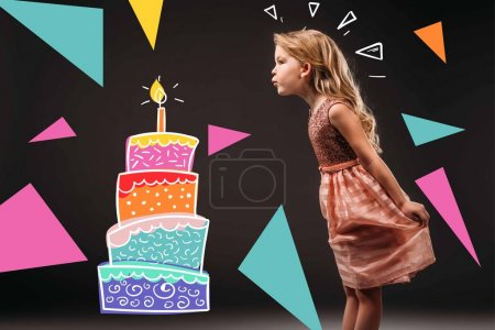 pretty child in pink dress blowing drawn candle on birthday cake, isolated on grey