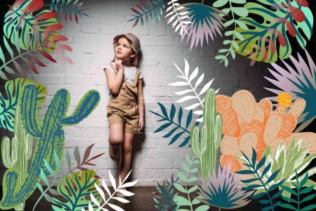 pensive child in safari costume standing at white wall with cactuses illustration