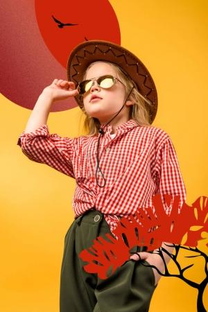 beautiful stylish tourist in hat and sunglasses, isolated on yellow with safari illustration