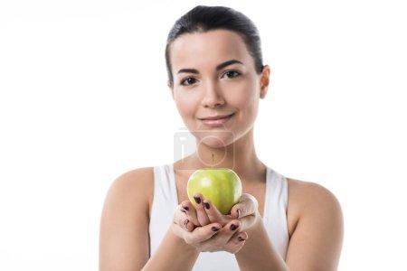 beautiful girl holding ripe apple isolated on white