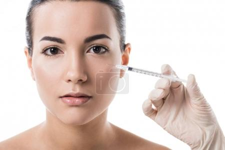 cropped image of beautician making beauty injection to girl with clean skin isolated on white