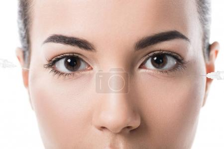cropped image of beautiful girl making beauty injections isolated on white