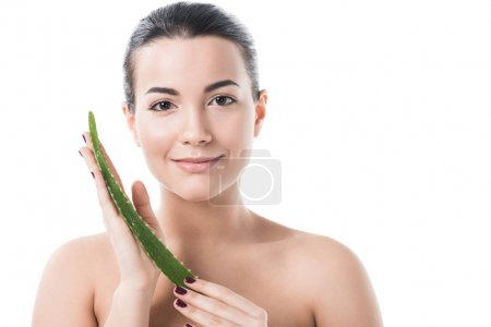 beautiful girl holding aloe vera leaf and looking at camera isolated on white