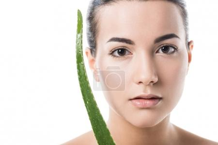 beautiful girl holding aloe vera leaf near face isolated on white
