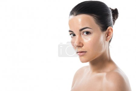 attractive girl with honey mask looking at camera isolated on white