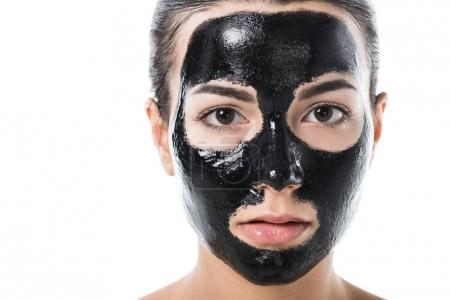 headshot of girl in cosmetic black clay facial mask isolated on white