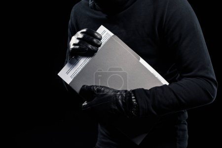 Close-up view of confident documents in hands of thief