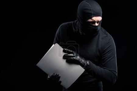 Photo pour Pénal à balaclava munies de documents confidentiels - image libre de droit