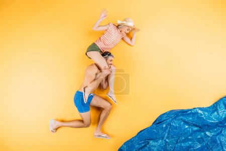 Photo for Happy young couple having fun together on imagine beach, summer vacation concept - Royalty Free Image