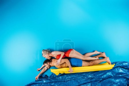 couple on inflatable mattress