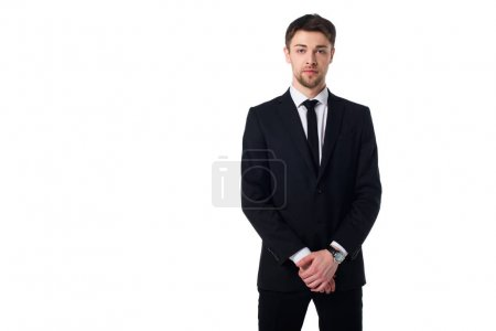 portrait of handsome agent in black suit looking at camera isolated on white