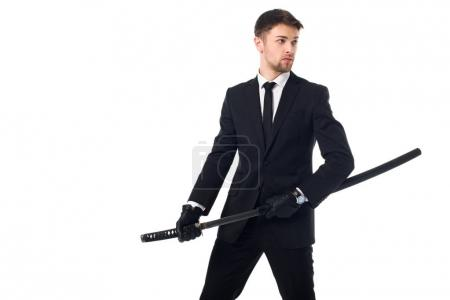 portrait of agent in suit and gloves with katana isolated on white