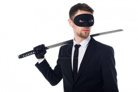 portrait of spy agent in mask and gloves with katana looking away isolated on white