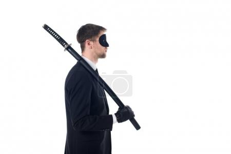 side view of spy agent in mask and gloves with katana isolated on white