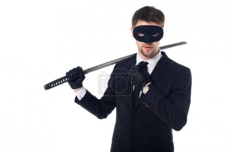 portrait of spy agent in mask and gloves with katana isolated on white