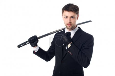 portrait of spy agent in suit and gloves holding katana isolated on white