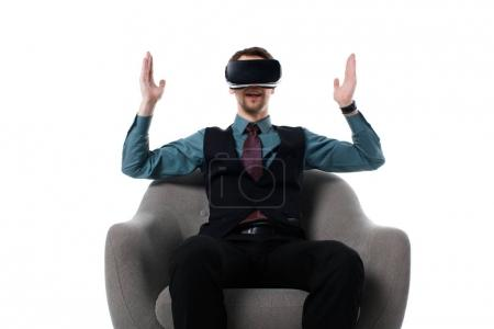 portrait of agent in virtual reality headset sitting in armchair isolated on white