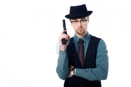 portrait of spy agent in hat and eyeglasses with gun isolated on white