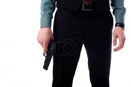 cropped shot of spy agent with gun in hand isolated on white