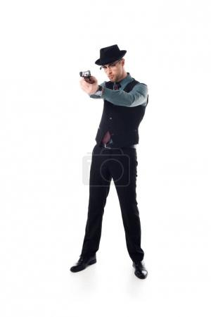 stylish spy agent in hat and eyeglasses with gun isolated on white