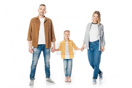 smiling family holding hands and looking at camera isolated on white