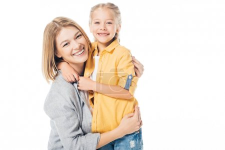 portrait of happy mother and cute daughter looking at camera while hugging each other isolated on white