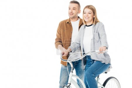 Photo for Smiling man and wife on bicycle looking away isolated on white - Royalty Free Image