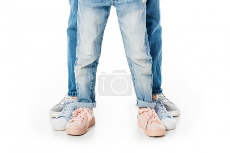partial view of family in jeans standing isolated on white