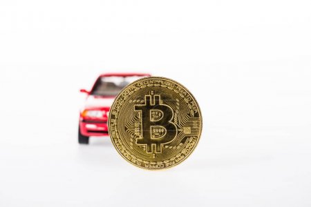 close-up view of bitcoin and red car isolated on white