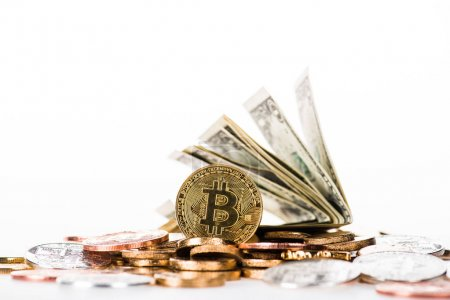 close-up view of bitcoins and dollar banknotes isolated on white