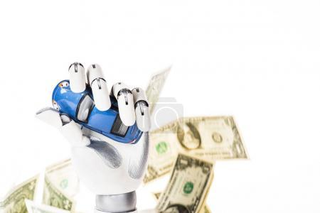 robotic arm holding small blue car model and dollar banknotes isolated on white