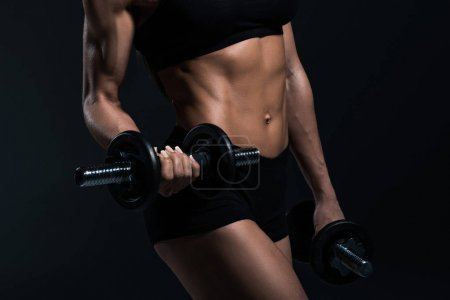 Photo for Midsection view of sportswoman training with dumbbells, isolated on grey - Royalty Free Image