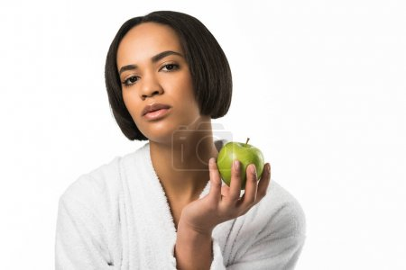 african american woman posing with apple,  isolated on white
