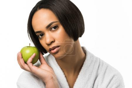 african american woman posing with organic apple,  isolated on white