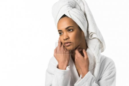tender african american woman in bathrobe and towel with perfect clean skin,  isolated on white