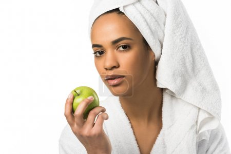 african american woman in towel posing with apple,  isolated on white