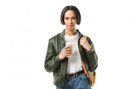 attractive african american student with backpack holding coffee cup, isolated on white