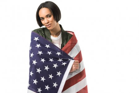 smiling african american girl wrapped in united states flag,  isolated on white